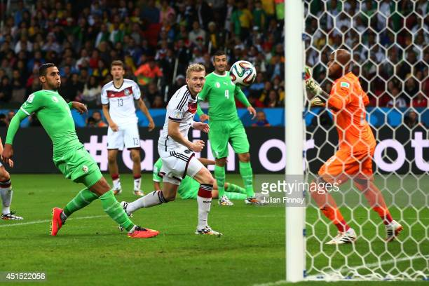 Andre Schuerrle of Germany scores his team's first goal past goalkeeper Rais M'Bolhi of Algeria in extra time during the 2014 FIFA World Cup Brazil...