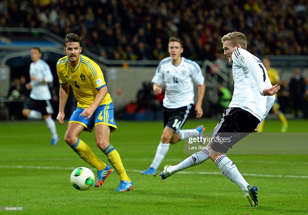 <a gi-track='captionPersonalityLinkClicked' href=/galleries/search?phrase=Andre+Schuerrle&family=editorial&specificpeople=5513825 ng-click='$event.stopPropagation()'>Andre Schuerrle</a> of Germany scores his teams fourth goal during the FIFA 2014 World Cup Qualifying Group C match between Sweden and Germany at Friends Arena Solna on October 15, 2013 in Stockholm, Sweden.