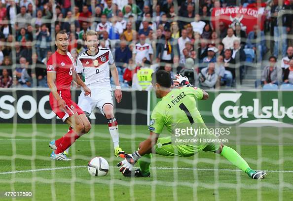 Andre Schuerrle of Germany scores the opening goal past goalkeeper Jordan Perez of Gibraltar during the UEFA EURO 2016 Qualifier Group D match...