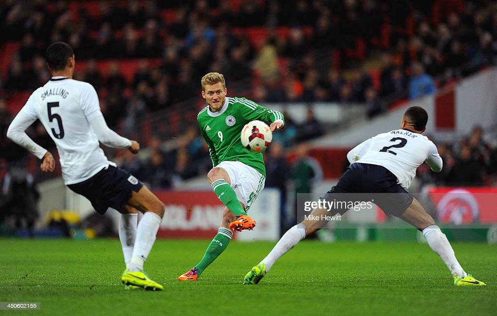 Andre Schuerrle of Germany shoots past Chris Smalling and Kyle Walker of England during the international friendly match between England and Germany...