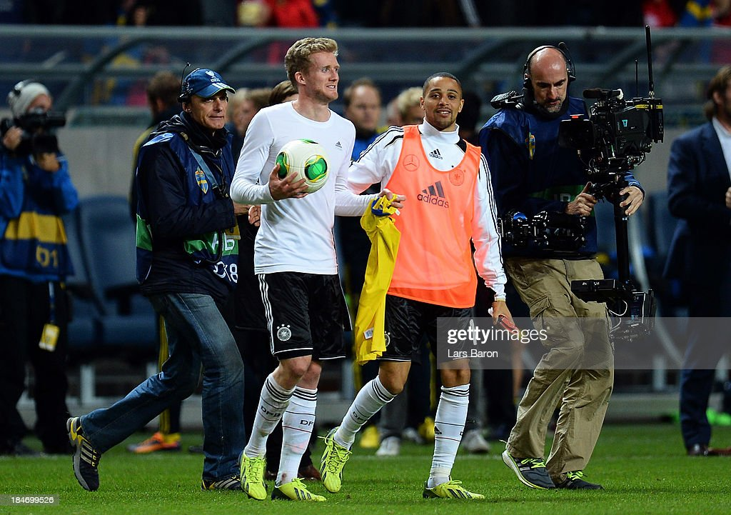 <a gi-track='captionPersonalityLinkClicked' href=/galleries/search?phrase=Andre+Schuerrle&family=editorial&specificpeople=5513825 ng-click='$event.stopPropagation()'>Andre Schuerrle</a> of Germany wo scored three goals take the ball after winning the FIFA 2014 World Cup Qualifying Group C match between Sweden and Germany at Friends Arena Solna on October 15, 2013 in Stockholm, Sweden.