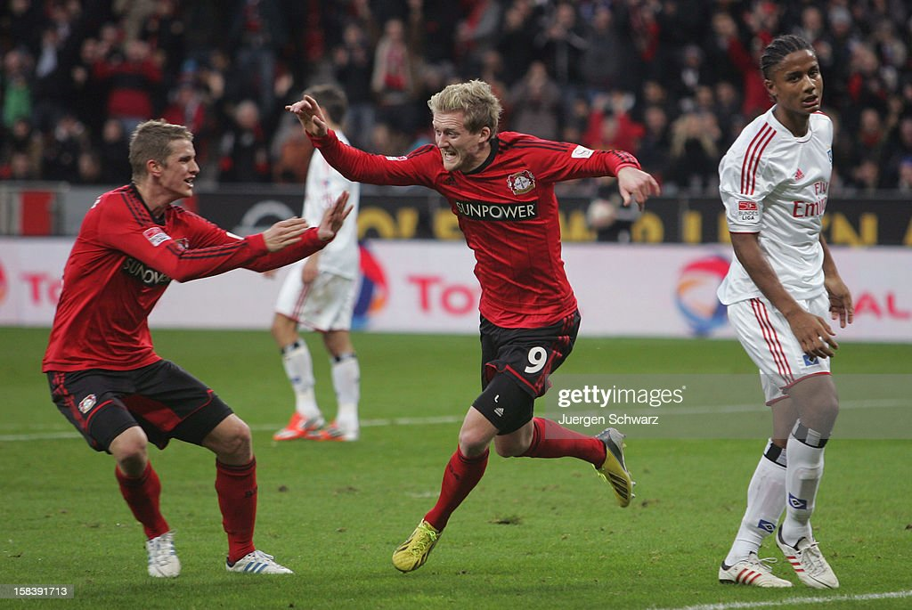 <a gi-track='captionPersonalityLinkClicked' href=/galleries/search?phrase=Andre+Schuerrle&family=editorial&specificpeople=5513825 ng-click='$event.stopPropagation()'>Andre Schuerrle</a> (C) of Leverkusen and <a gi-track='captionPersonalityLinkClicked' href=/galleries/search?phrase=Lars+Bender&family=editorial&specificpeople=644948 ng-click='$event.stopPropagation()'>Lars Bender</a> (L) celebrate beside <a gi-track='captionPersonalityLinkClicked' href=/galleries/search?phrase=Michael+Mancienne&family=editorial&specificpeople=978199 ng-click='$event.stopPropagation()'>Michael Mancienne</a> of Hamburg during the Bundesliga match between Bayer Leverkusen and Hamburger SV at BayArena on December 15, 2012 in Leverkusen, Germany.