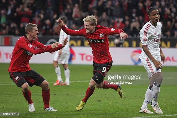 Andre Schuerrle of Leverkusen and Lars Bender celebrate beside Michael Mancienne of Hamburg during the Bundesliga match between Bayer Leverkusen and...
