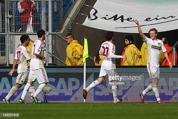 Andre Schuerrle of Leverkusen celebrates his team's first goal with team mates Gonzalo Castro Tranquillo Barnetta and Michael Ortega during the...