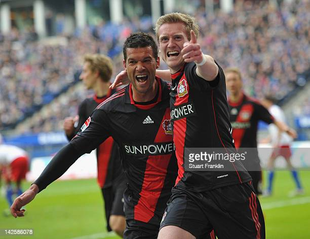 Andre Schuerrle of Leverkusen celebrates scoring his goal with Michael Ballack during the Bundesliga match between Hamburger SV and Bayer 04...