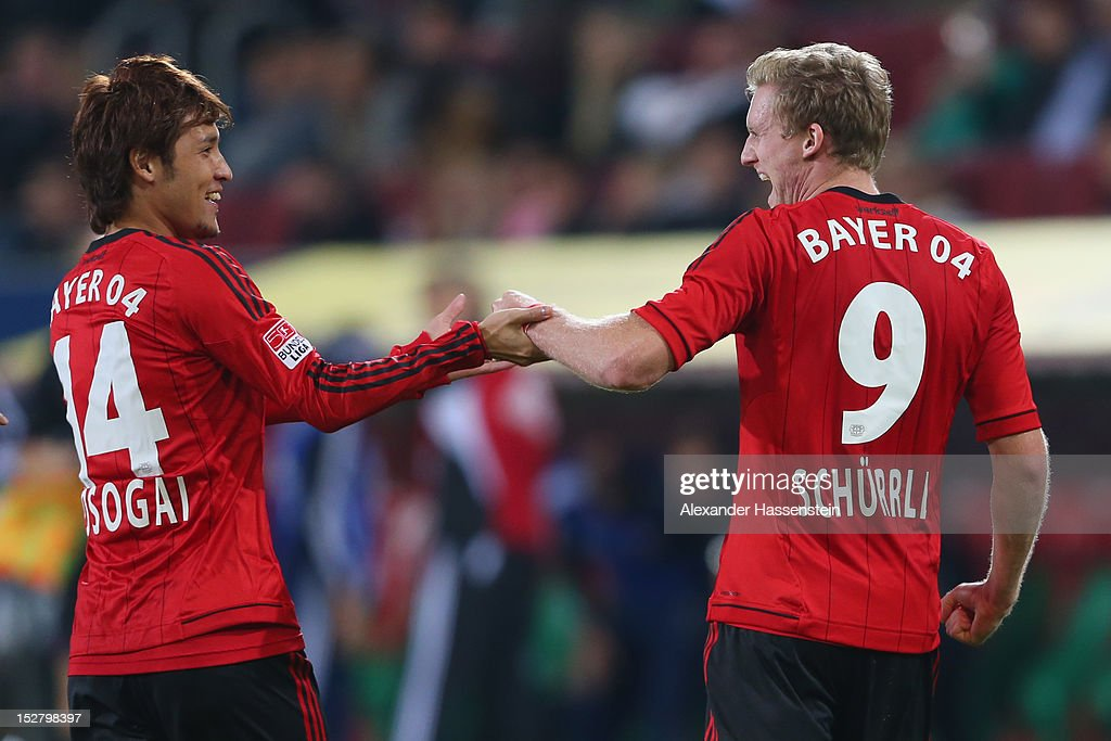 Andre Schuerrle (R) of Leverkusen celebrates scoring the third team goal with his team mate <a gi-track='captionPersonalityLinkClicked' href=/galleries/search?phrase=Hajime+Hosogai&family=editorial&specificpeople=4023693 ng-click='$event.stopPropagation()'>Hajime Hosogai</a> during the Bundesliga match between FC Augsburg and Bayer 04 Leverkusen at SGL Arena on September 26, 2012 in Augsburg, Germany.