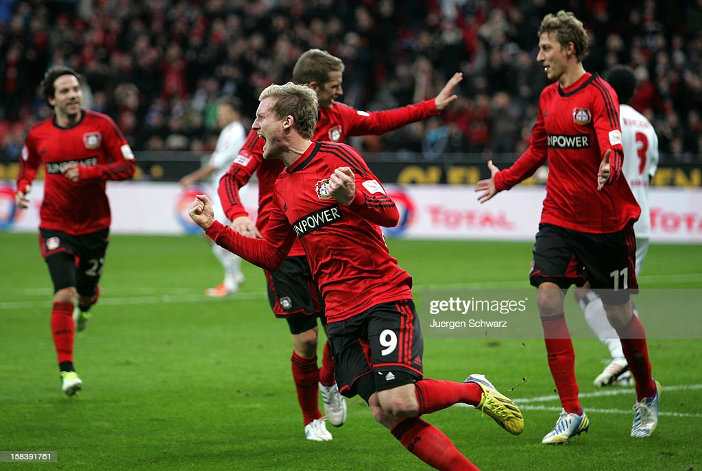 <a gi-track='captionPersonalityLinkClicked' href=/galleries/search?phrase=Andre+Schuerrle&family=editorial&specificpeople=5513825 ng-click='$event.stopPropagation()'>Andre Schuerrle</a> (C) of Leverkusen celebrates with (L-R) <a gi-track='captionPersonalityLinkClicked' href=/galleries/search?phrase=Gonzalo+Castro&family=editorial&specificpeople=605388 ng-click='$event.stopPropagation()'>Gonzalo Castro</a>, <a gi-track='captionPersonalityLinkClicked' href=/galleries/search?phrase=Lars+Bender&family=editorial&specificpeople=644948 ng-click='$event.stopPropagation()'>Lars Bender</a> and <a gi-track='captionPersonalityLinkClicked' href=/galleries/search?phrase=Stefan+Kiessling&family=editorial&specificpeople=605405 ng-click='$event.stopPropagation()'>Stefan Kiessling</a> during the Bundesliga match between Bayer Leverkusen and Hamburger SV at BayArena on December 15, 2012 in Leverkusen, Germany.