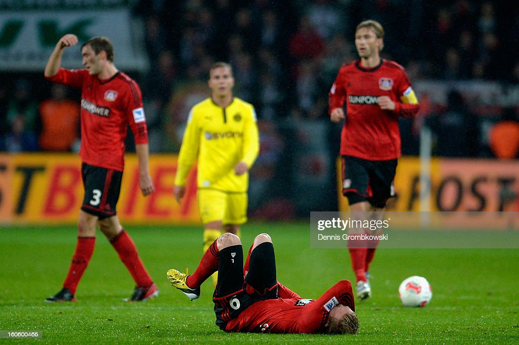 Andre Schuerrle of Leverkusen lies on the pitch during the Bundesliga match between Bayer 04 Leverkusen and Borussia Dortmund at BayArena on February 3, 2013 in Leverkusen, Germany.
