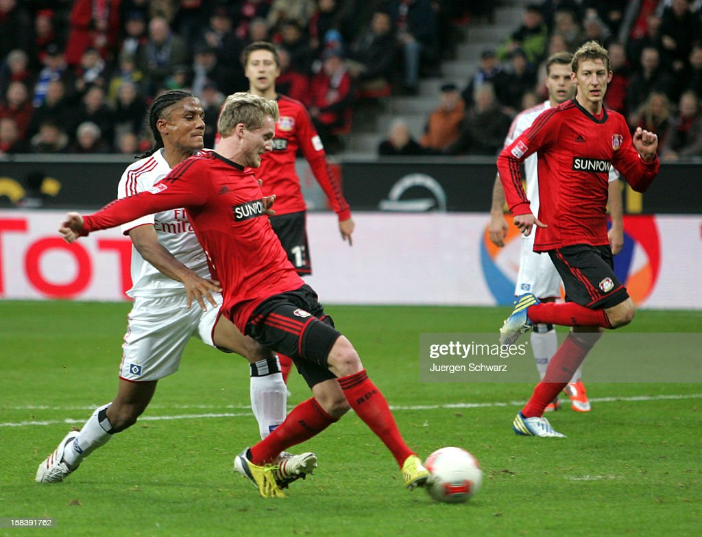 <a gi-track='captionPersonalityLinkClicked' href=/galleries/search?phrase=Andre+Schuerrle&family=editorial&specificpeople=5513825 ng-click='$event.stopPropagation()'>Andre Schuerrle</a> (2ndL) of Leverkusen scores beside <a gi-track='captionPersonalityLinkClicked' href=/galleries/search?phrase=Michael+Mancienne&family=editorial&specificpeople=978199 ng-click='$event.stopPropagation()'>Michael Mancienne</a> of Hamburg during the Bundesliga match between Bayer Leverkusen and Hamburger SV at BayArena on December 15, 2012 in Leverkusen, Germany.