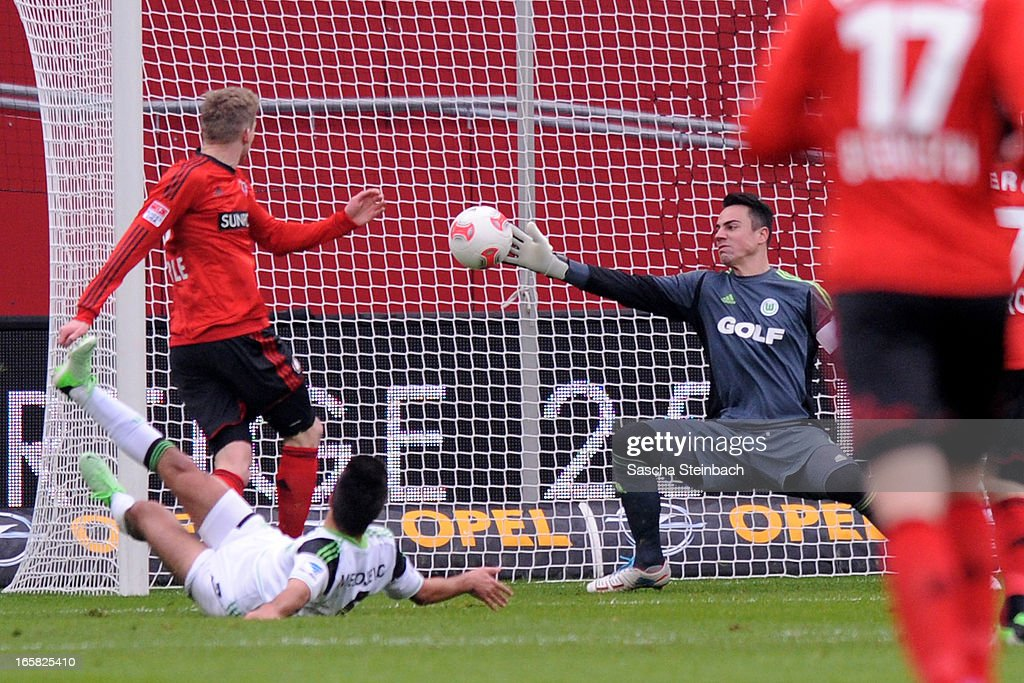 Andre Schuerrle (L) of Leverkusen scores the opening goal during the Bundesliga match between Bayer 04 Leverkusen and VfL Wolfsburg at BayArena on April 6, 2013 in Leverkusen, Germany.