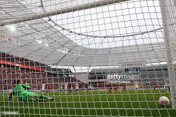 Andre Schuerrle of Leverkusen shoots the penalty at the goalpost against MarcAndre ter Stegen of Moenchengladbach during the Bundesliga match between...