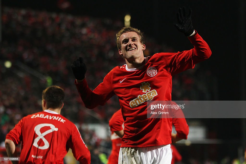 <a gi-track='captionPersonalityLinkClicked' href=/galleries/search?phrase=Andre+Schuerrle&family=editorial&specificpeople=5513825 ng-click='$event.stopPropagation()'>Andre Schuerrle</a> of Mainz celebrates his team's first goal during the Bundesliga match between FSV Mainz 05 and 1. FC Nuernberg at Bruchweg Stadium on November 26, 2010 in Mainz, Germany.