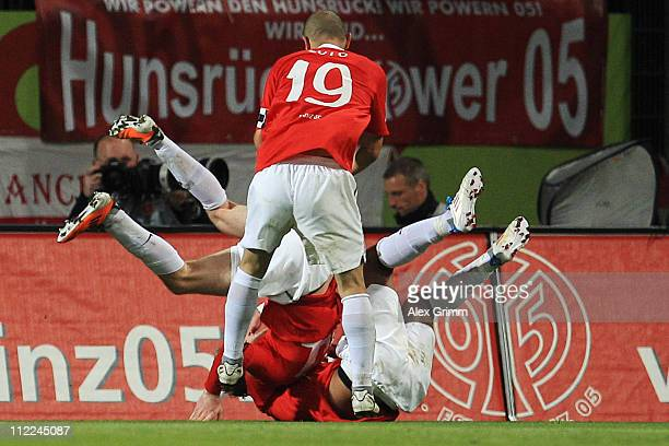 Andre Schuerrle of Mainz celebrates his team's first goal with team mates Sami Allagui and Elkin Soto during the Bundesliga match between FSV Mainz...