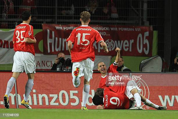 Andre Schuerrle of Mainz celebrates his team's first goal with team mates Elkin Soto Sami Allagui Jan Kirchhoff and Petar Sliskovic during the...