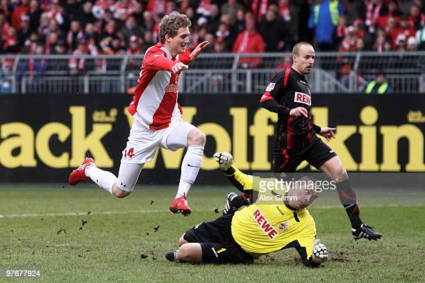 Andre Schuerrle of Mainz scores his team's first goal against goalkeeper Faryd Mondragon and Miso Brecko of Koeln during the Bundesliga match between...