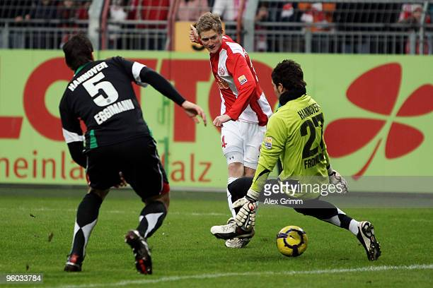 Andre Schuerrle of Mainz scores his team's first goal against Mario Eggimann and goalkeeper Florian Fromlowitz during the Bundesliga match between...