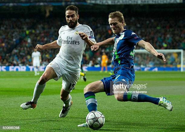 Andre Schuerrle of VfL Wolfsburg is watched by Daniel Carvajal of Real Madrid during the UEFA Champions League quarter final second leg match between...