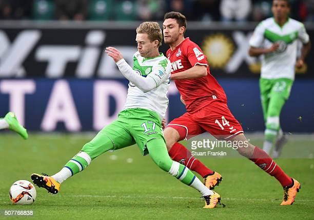 Andre Schuerrle of VfL Wolfsburg takes on Jonas Hector of Cologne during the Bundesliga match between VfL Wolfsburg and 1 FC Koeln at Volkswagen...
