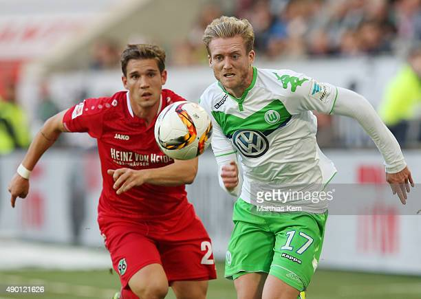 Andre Schuerrle of Wolfsburg battles for the ball with Oliver Sorg of Hannover during the Bundesliga match between VFL Wolfsburg and Hannover 96 at...