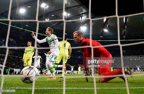 Andre Schuerrle of Wolfsburg celebrates after scoring his teams first goal during the UEFA Champions League Round of 16 Second Leg match between VfL...