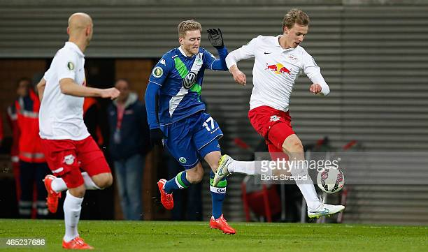 Andre Schuerrle of Wolfsburg challenges Lukas Klostermann of Leipzig during the DFB Cup round of sixteen match between RB Leipzig and VfL Wolfsburg...