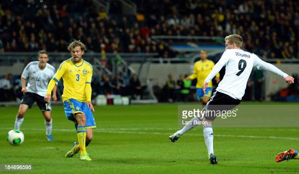 Andre Schuerrle scores his teams third goal during the FIFA 2014 World Cup Qualifying Group C match between Sweden and Germany at Friends Arena Solna...