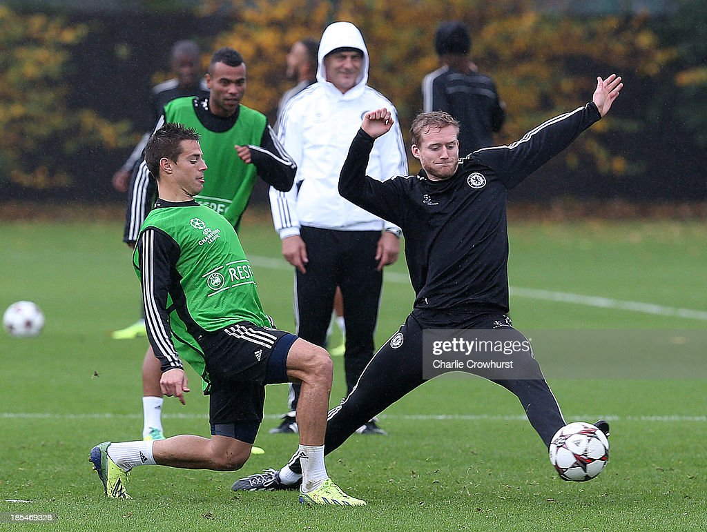 Andre Schurrle looks to intercept Cesar Azpilicueta's pass during a Chelsea training session ahead of their UEFA Champions League Group E match...