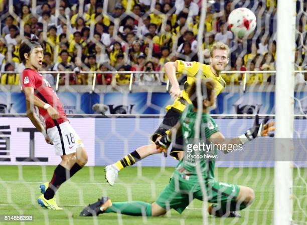 Andre Schurrle of Borussia Dortmund scores the gamewinning goal during the second half of a friendly against Urawa Reds at Saitama Stadium near Tokyo...
