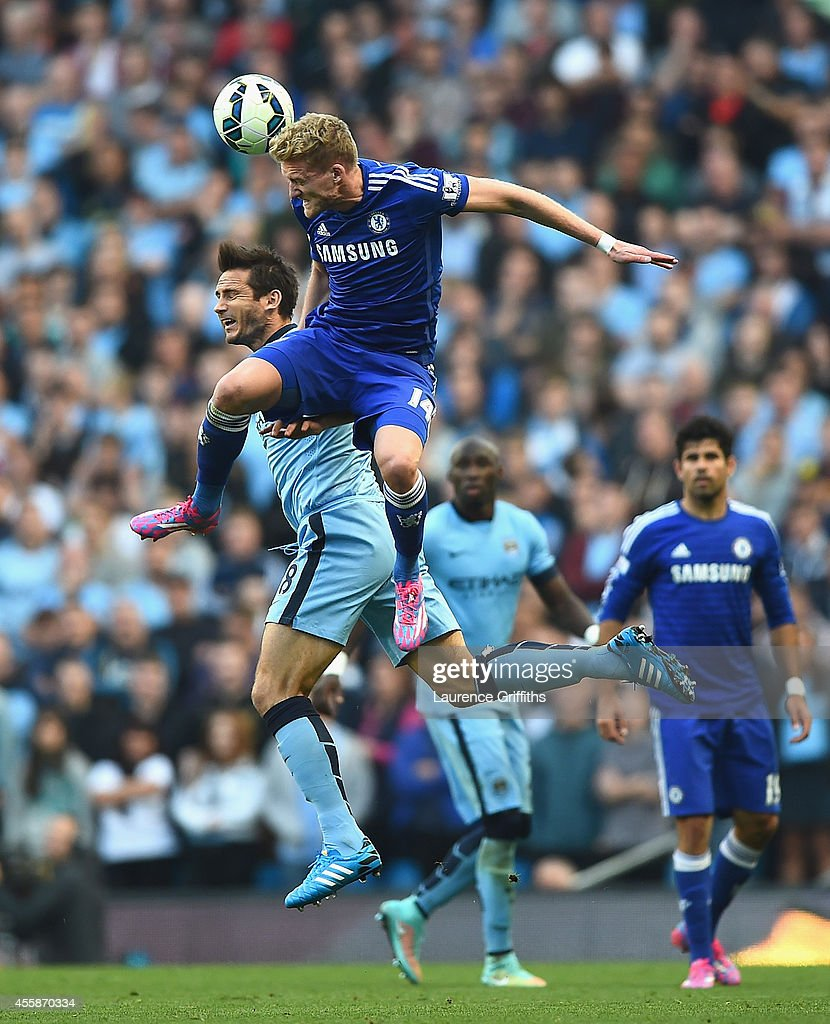 Andre Schurrle of Chelsea battles with Frank Lampard of Manchester City during the Barclays Premier League match between Manchester City and Chelsea...