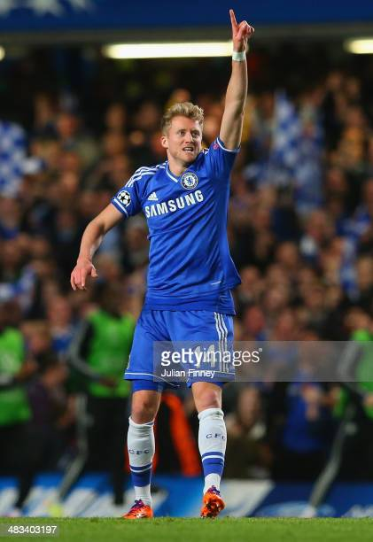 Andre Schurrle of Chelsea celebrates scoring their first goal during the UEFA Champions League Quarter Final second leg match between Chelsea and...