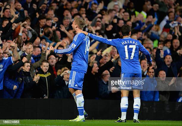 Andre Schurrle of Chelsea celebrates scoring their first goal qith Eden Hazard of Chelsea during the Barclays Premier League match between Chelsea...