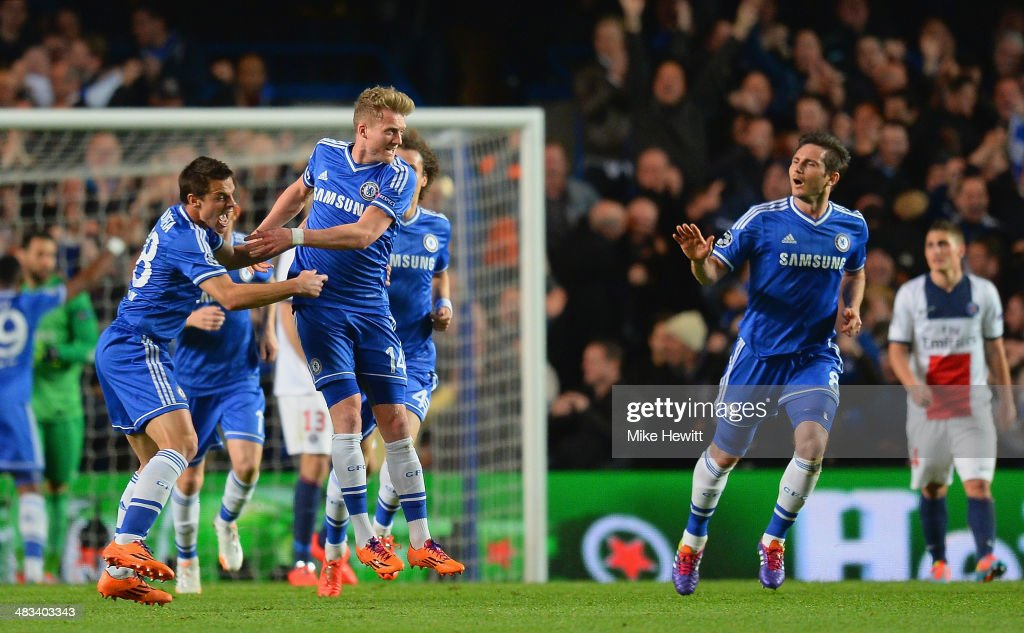 Andre Schurrle of Chelsea celebrates scoring their first goal with Cesar Azpilicueta and <a gi-track='captionPersonalityLinkClicked' href=/galleries/search?phrase=Frank+Lampard+-+Born+1978&family=editorial&specificpeople=11497645 ng-click='$event.stopPropagation()'>Frank Lampard</a> of Chelsea (R) during the UEFA Champions League Quarter Final second leg match between Chelsea and Paris Saint-Germain FC at Stamford Bridge on April 8, 2014 in London, England.
