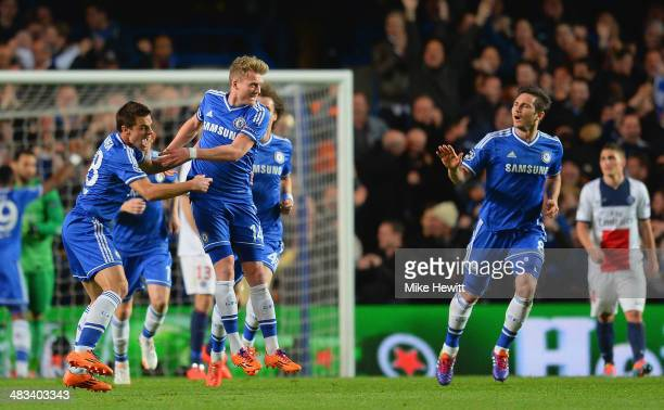 Andre Schurrle of Chelsea celebrates scoring their first goal with Cesar Azpilicueta and Frank Lampard of Chelsea during the UEFA Champions League...