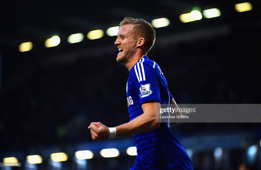 Andre Schurrle of Chelsea celebrates scoring their second goal during the Barclays Premier League match between Burnley and Chelsea at Turf Moor on August 18, 2014 in Burnley, England.