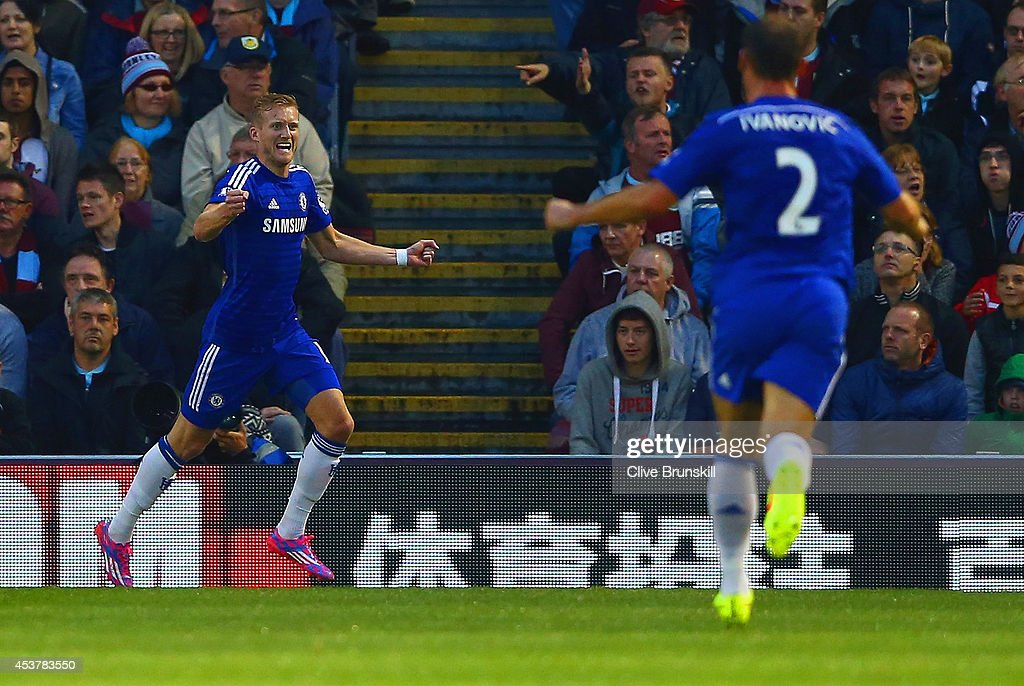 Andre Schurrle of Chelsea celebrates scoring their second goal with <a gi-track='captionPersonalityLinkClicked' href=/galleries/search?phrase=Branislav+Ivanovic&family=editorial&specificpeople=607152 ng-click='$event.stopPropagation()'>Branislav Ivanovic</a> of Chelsea during the Barclays Premier League match between Burnley and Chelsea at Turf Moor on August 18, 2014 in Burnley, England.