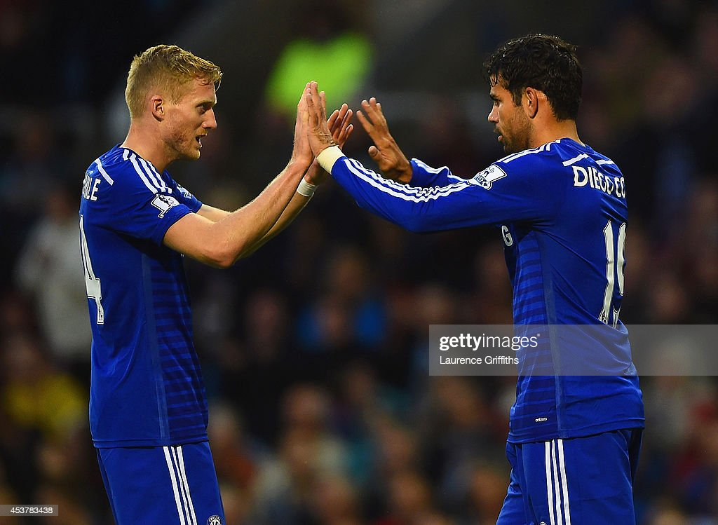 Andre Schurrle of Chelsea congratulates Diego Costa of Chelsea on scoring their first goal during the Barclays Premier League match between Burnley and Chelsea at Turf Moor on August 18, 2014 in Burnley, England.