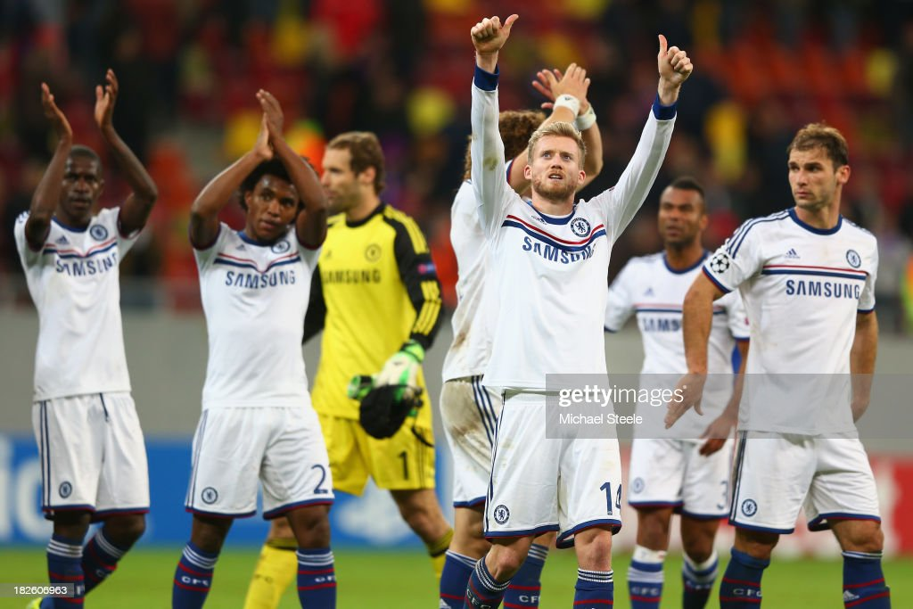Andre Schurrle (2R) of Chelsea gives the thumbs up to the travelling supporters after his 4-0 win during the UEFA Champions League Group E Match between FC Steaua Bucuresti and Chelsea at the National Arena Stadium on October 1, 2013 in Bucharest, Romania.