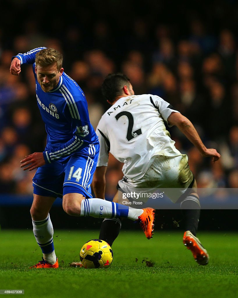 Andre Schurrle of Chelsea goes past Jordi Amat of Swansea City during the Barclays Premier League match between Chelsea and Swansea City at Stamford Bridge on December 26, 2013 in London, England.