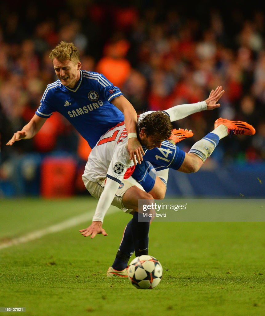 Andre Schurrle of Chelsea is fouled by Maxwell of PSG during the UEFA Champions League Quarter Final second leg match between Chelsea and Paris Saint-Germain FC at Stamford Bridge on April 8, 2014 in London, England.