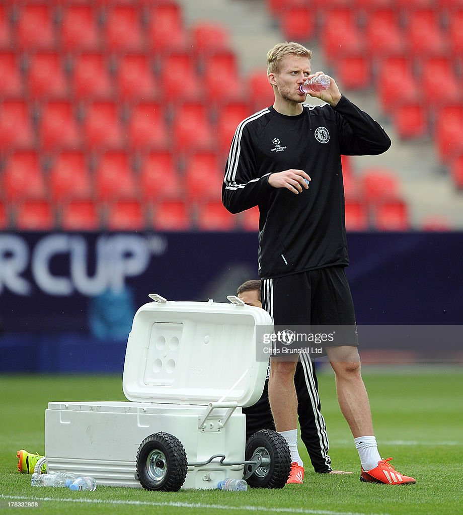 Andre Schurrle of Chelsea takes a drink during the Chelsea training session at Eden Stadium on August 29, 2013 in Prague, Czech Republic.