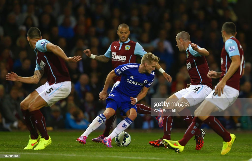 Andre Schurrle of Chelsea tries to find a way through the Burnley defense during the Barclays Premier League match between Burnley and Chelsea at Turf Moor on August 18, 2014 in Burnley, England.