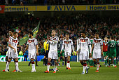Andre Schurrle of Germany leads his team as they applaud the fans after defeat during the UEFA EURO 2016 Qualifier group D match between Republic of...