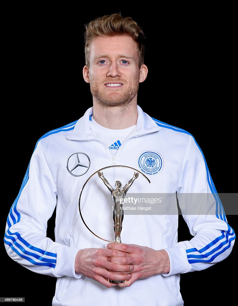 Andre Schurrle of Germany, winners of the Laureus World Team of the Year 2015 poses with the award at the Villa Kennedy hotel on March 23, 2015 in Frankfurt, Germany.