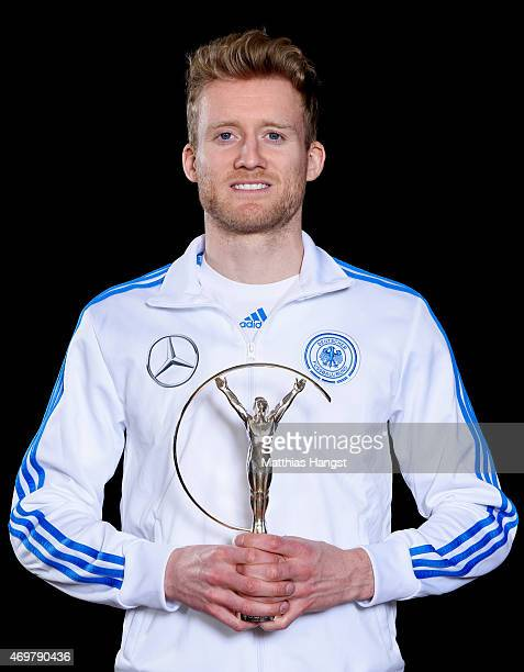 Andre Schurrle of Germany winners of the Laureus World Team of the Year 2015 poses with the award at the Villa Kennedy hotel on March 23 2015 in...