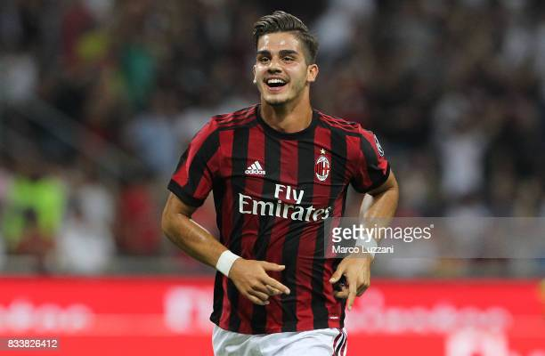 Andre Silva of AC Milan celebrates after scoring the opening goal during the UEFA Europa League Qualifying PlayOffs round first leg match between AC...