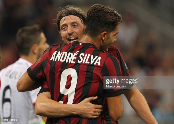 Andre Silva of AC Milan celebrates his second goal with his teammate Riccardo Montolivo during the UEFA Europa League Qualifying PlayOffs round first...