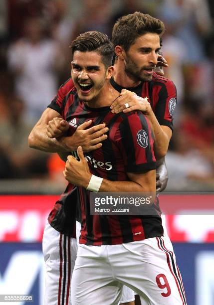 Andre Silva of AC Milan celebrates his second goal with his teammate Fabio Borini during the UEFA Europa League Qualifying PlayOffs round first leg...
