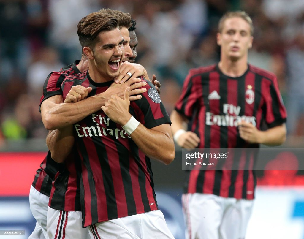 Andre Silva of AC Milan (front) celebrates with his team-mate Fabio Borini after scoring his second goal during the UEFA Europa League Qualifying Play-Offs round first leg match between AC Milan and KF Shkendija 79 at Stadio Giuseppe Meazza on August 17, 2017 in Milan, Italy.