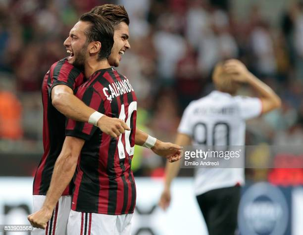 Andre Silva of AC Milan celebrates with his teammate Hakan Calhanoglu after scoring his second goal during the UEFA Europa League Qualifying PlayOffs...