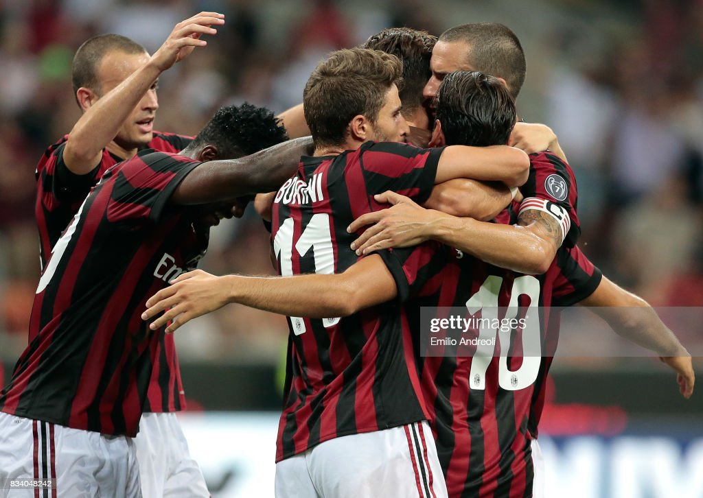 Andre Silva of AC Milan celebrates with his team-mates after scoring the opening goal during the UEFA Europa League Qualifying Play-Offs round first leg match between AC Milan and KF Shkendija 79 at Stadio Giuseppe Meazza on August 17, 2017 in Milan, Italy.